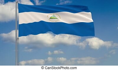 Flag of Nicaragua against background of clouds sky