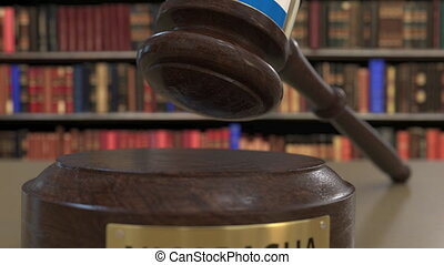Flag of Nicaragua on falling judges gavel in court. National...