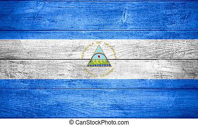 flag of Nicaragua or Nicaraguan banner on wooden background