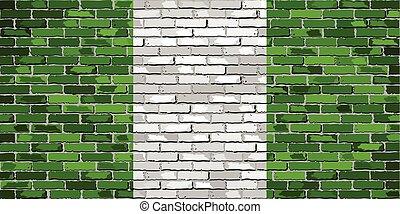 Flag of Nigeria on a brick wall