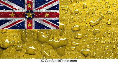 flag of Niue with rain drops