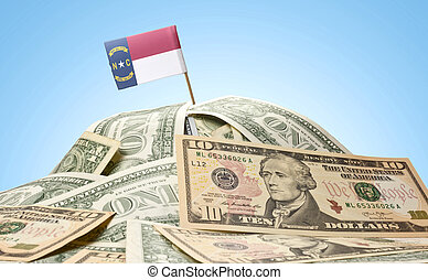 Flag of North Carolina sticking in a pile of american dollars.(series)