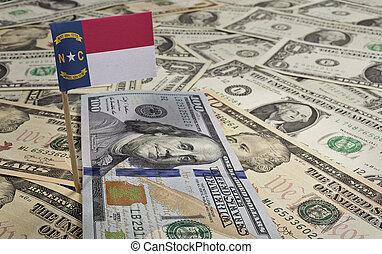 Flag of North Carolina sticking in various american banknotes.(series)