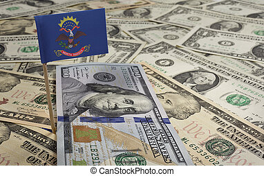Flag of North Dakota sticking in various american banknotes.(series)