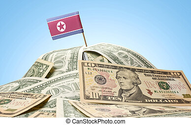 Flag of North Korea sticking in a pile of american dollars.(series)