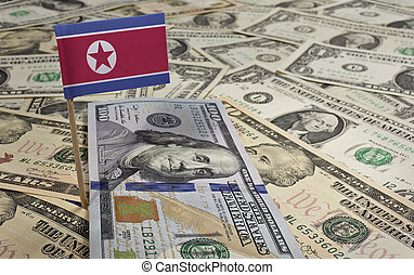 Flag of North Korea sticking in various american banknotes.(series)