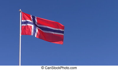 Flag of Norway against blue sky
