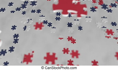 Flag of Norway being made with jigsaw puzzle pieces....