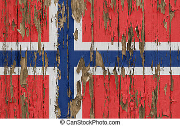 Flag of Norway on a weathered wooden wall