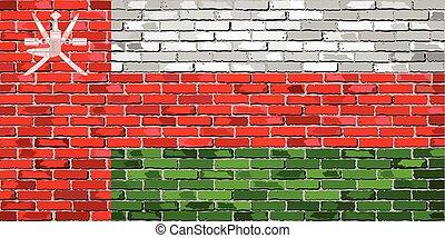 Flag of Oman on a brick wall