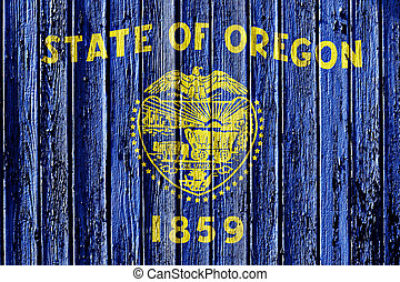 flag of Oregon painted on wooden frame