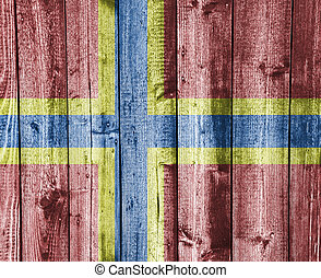 Flag of Orkney Islands on weathered wood