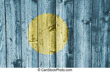 Flag of Palau on weathered wood