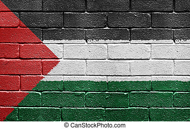 Flag of Palestine painted onto a grunge brick wall