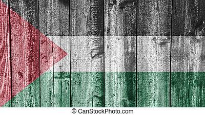 Flag of Palestine on weathered wood