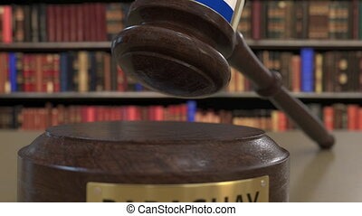 Flag of Paraguay on falling judges gavel in court. National...