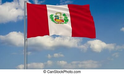 Flag of Peru against background of clouds