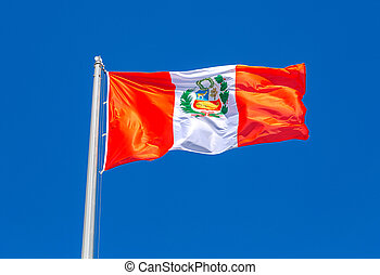 Flag of Peru waving in the wind against the sky