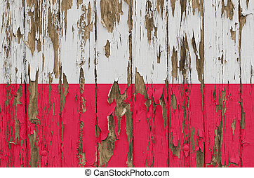 Flag of Poland on a weathered wooden wall
