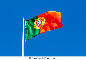 Flag of Portugal waving in the wind against the sky