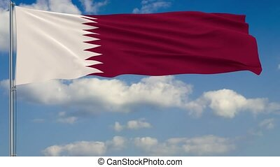 Flag of Qatar against background of clouds sky