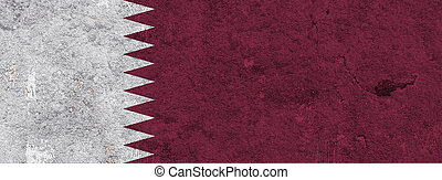 Flag of Qatar on weathered concrete