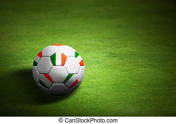 Flag of Republic of Ireland with soccer ball over grass background - Euro 2012 championship
