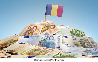 Flag of Romania sticking in a pile of various european banknotes.(series)