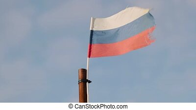 flag of Russia is flying in the wind.