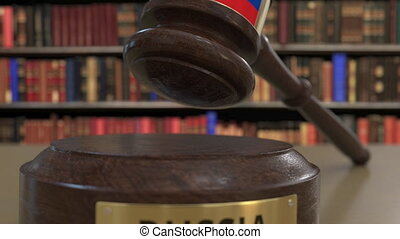 Flag of Russia on falling judges gavel in court. National...