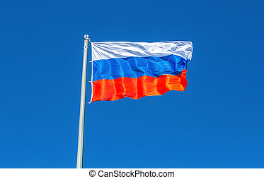 Flag of Russia waving in the wind against the sky