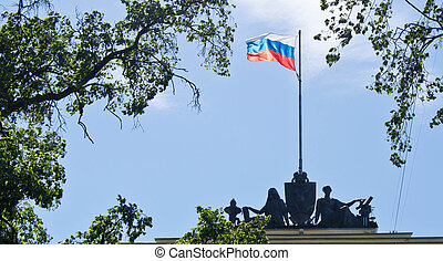 flag of Russian Federation on the house with statues