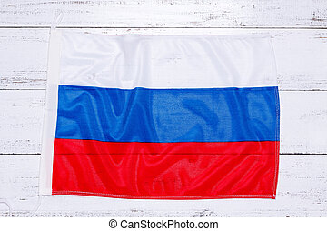 Flag of russian federation on white wooden background.