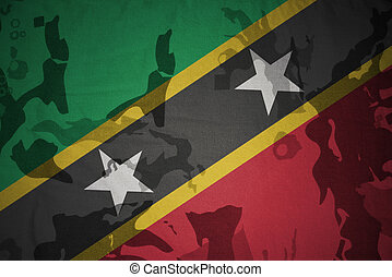 flag of saint kitts and nevis on the khaki texture . military concept