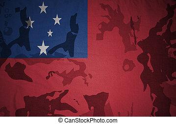 flag of Samoa on the khaki texture . military concept
