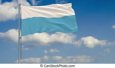 Flag of San Marino against background clouds sky