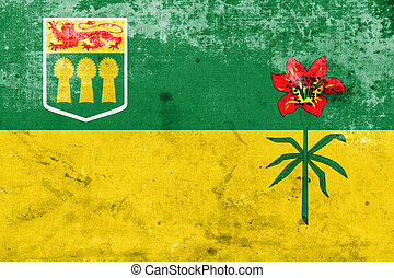 Flag of Saskatchewan Province, Canada, with a vintage and old lo