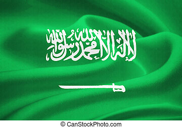 Flag of Saudi Arabia waving in the wind. Silk texture...