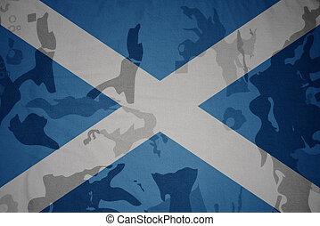 flag of scotland on the khaki texture . military concept