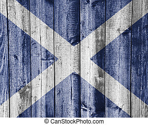 Flag of Scotland on weathered wood