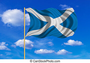 Flag of Scotland waving on blue sky background