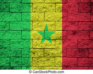 Flag of Senegal painted onto a grunge brick wall