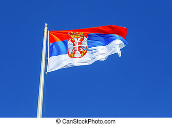 Flag of Serbia flying in the wind against the sky
