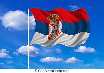 Flag of Serbia waving on blue sky background