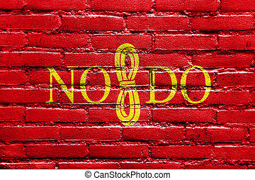 Flag of Seville, Spain, painted on brick wall