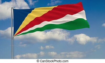Flag of Seychelles against background of clouds