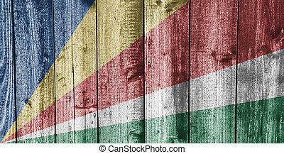 Flag of Seychelles on weathered wood