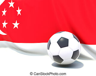 Flag of singapore with football in front of it