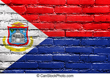 Flag of Sint Maarten, painted on brick wall