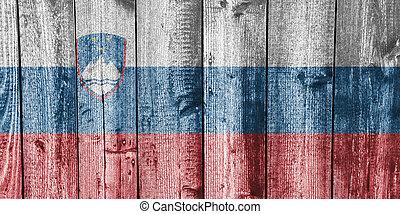 Flag of Slovenia on weathered wood